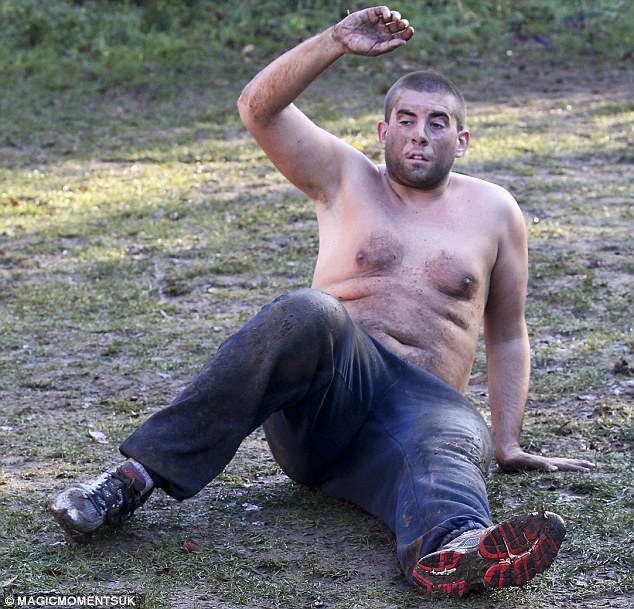 Exhausting: The 24-year-old star looked tired out as he was put through his paces by a personal trainer at the No1 Boot Camp in Norfolk