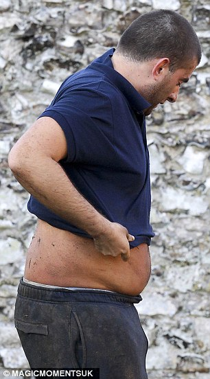 Is it working? The TOWIE star seemed to be checking out whether the gruelling diet and exercise regime had had an effect on him