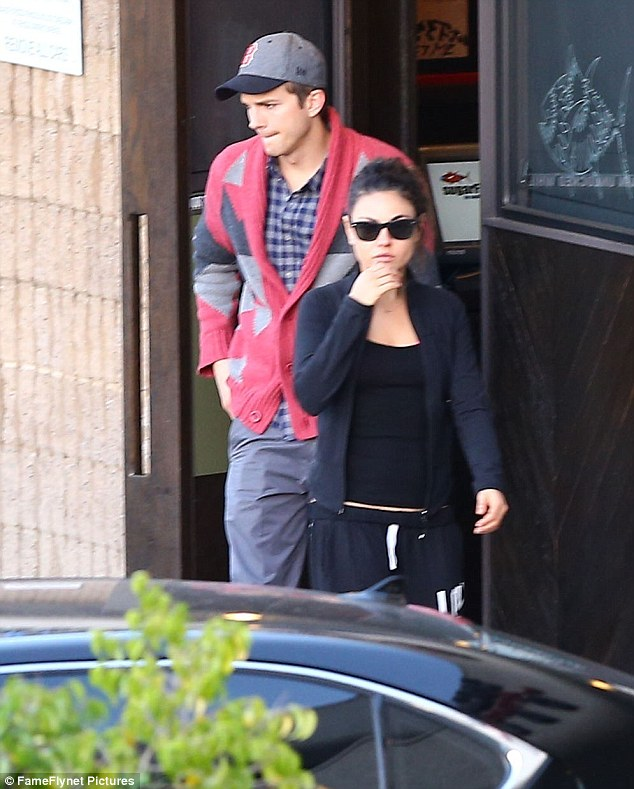 Sushi time: Mila and Ashton are pictured leaving a sushi restaurant in North Hollywood on Friday in their trademark casual attire