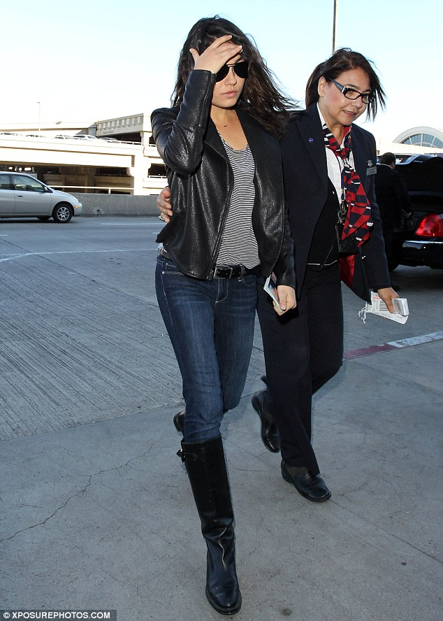 Take off: The 29-year-old sported a leather jacket and jodhpur boots for her travels as she shielded her eyes from the sun