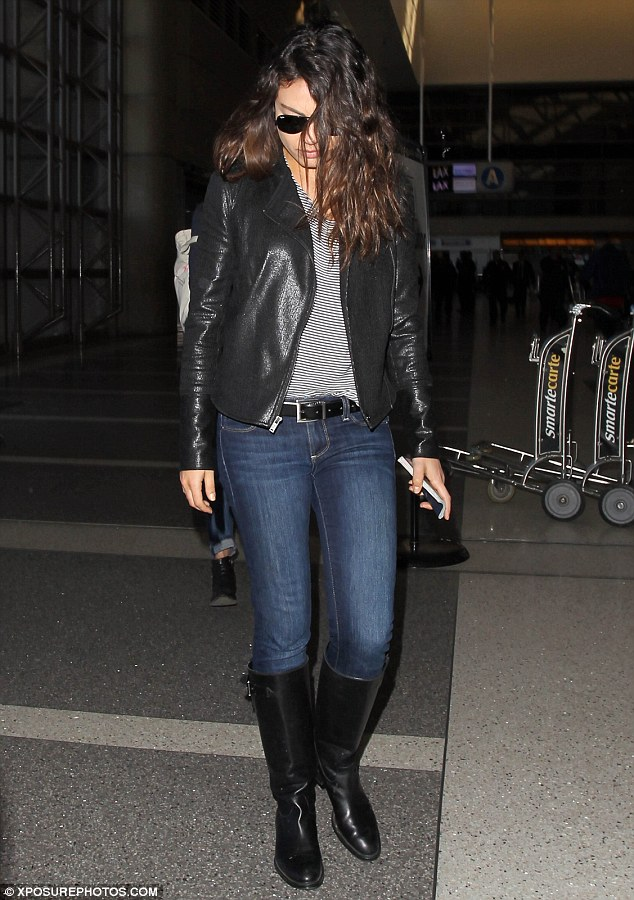Moussed: Mina Kunis leaves Los Angeles International Airport on Monday looking tousle-haired and airplane ready