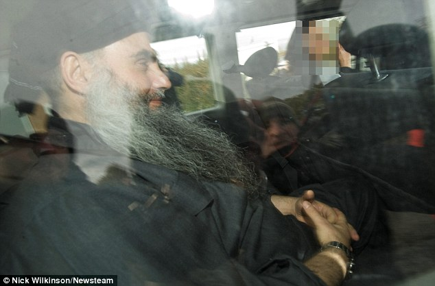Camera flashes: Qatada was freed on bail terms that allow him to roam the streets for eight hours every day