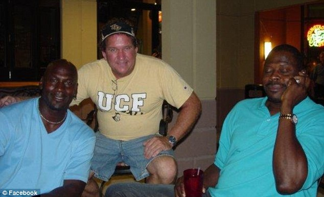 Famous friends: Gregory Faull is seen here with basketball legends Michael Jordan, left, and Patrick Ewing, right