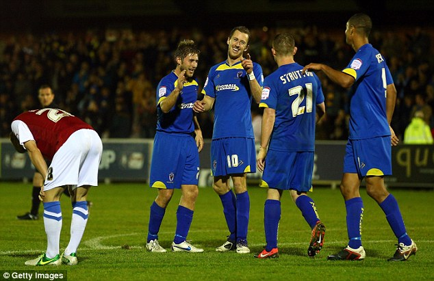 Grudge match: Jack Midson (centre) celebrates after scoring what turned out to be the winner on Monday night
