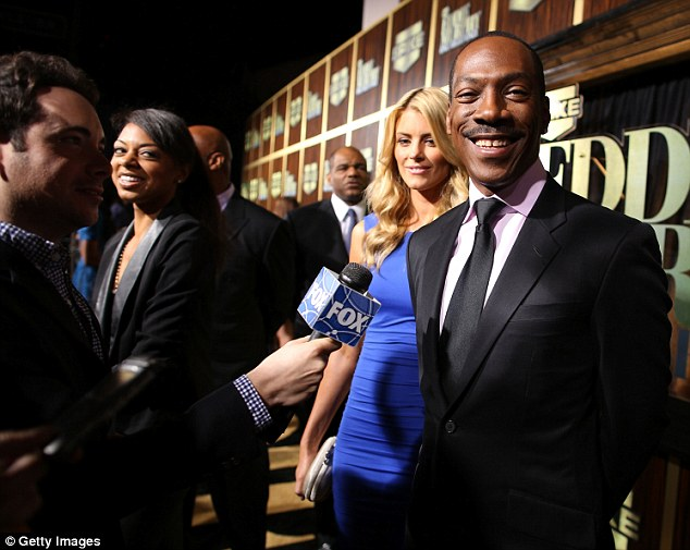 Arm candy: Paige was also seen dutifully sitting beside the womanising funnyman earlier this month at Spike TV's Eddie Murphy: One Night Only at the Saban Theatre