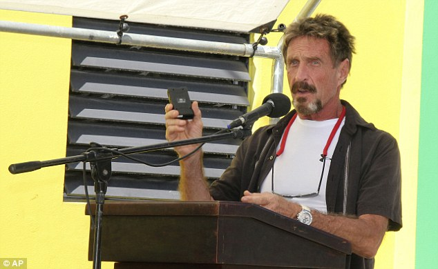 On the run: John McAfee, seen here just days before the murder of his neighbor, claims he is being set up by the Belizean government