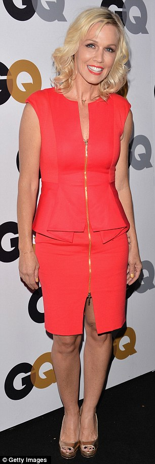 Red-hot: Jennie Garth also showed off her sensational figure in a peplum dress of the same hue, featuring a racy zipper all the way up the front