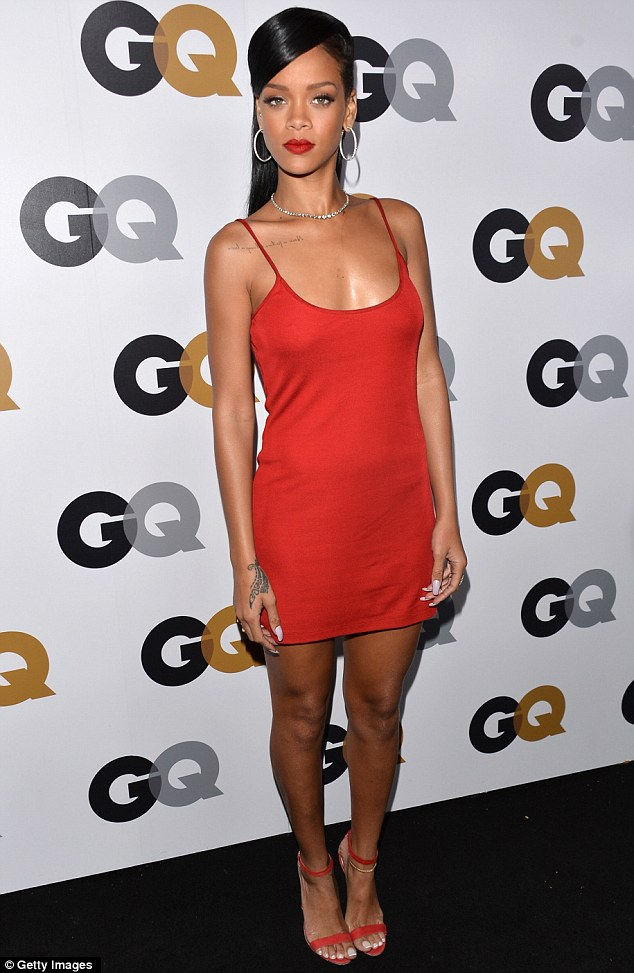 Scarlet woman! Rihanna raised temperatures at the GQ Men of the Year party at Chateau Marmont on Tuesday night by slipping into a racy red-hot dress
