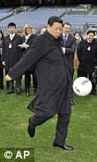 Chinese Vice President Xi Jinping kicks a football during visit to Croke Park Stadium, Dublin, Ireland.