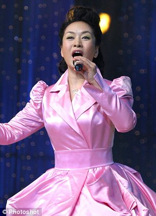 Power couple: Xi Jinping is married to Peng Liyuan, the syrup-voiced megastar of popular Chinese folk music