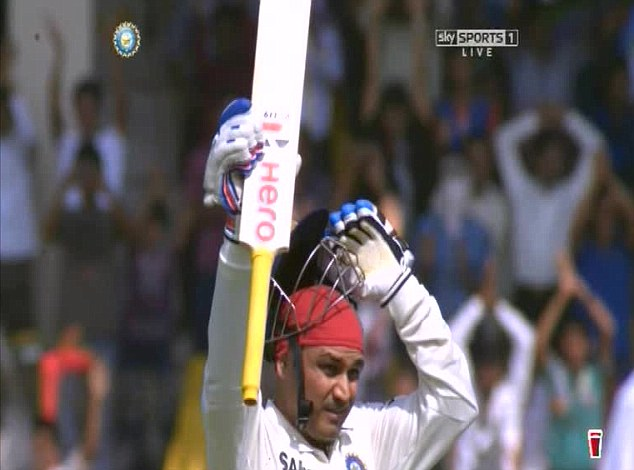 What a start: Indian opener Virender Sehwag celebrates his hundred in Ahmedabad