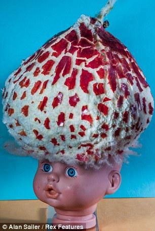 Apple on doll's head
