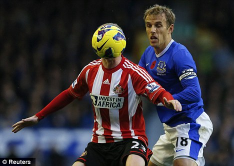 Deal him in: David Moyes wants Everton to extend veteran skipper Phil Neville's stay at Goodison Park