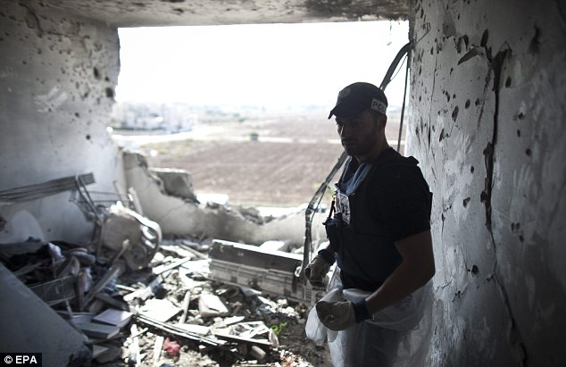 Devastation: A Zaka volunteer stands in the living room of an apartment building that was hit