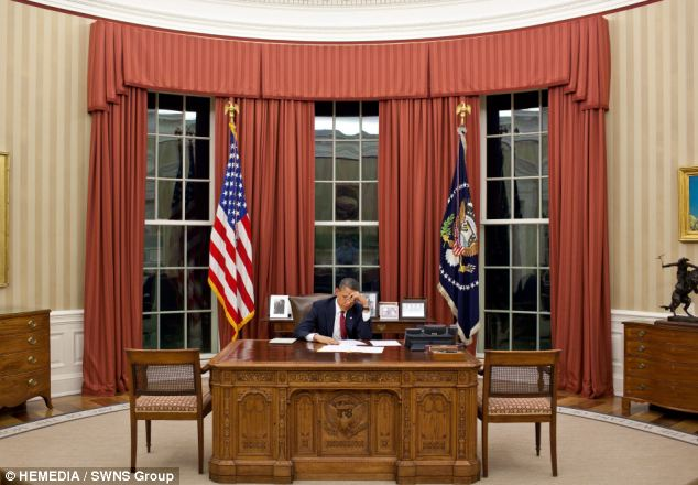 Grand: President Barack Obama in the Oval Office with the curtains made by Bob Galbraith at his Scottish factory in Biggar, South Lanarkshire