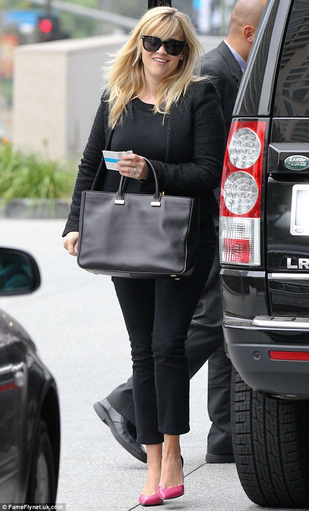 So stylish: Reese Witherspoon was spotted on her way to a meeting in Los Angeles on Thursday and was dressed like she meant busines