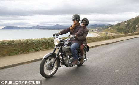 Slowing down: Riding a Triumph motorcycle along the coastline in Dublin in the film Once