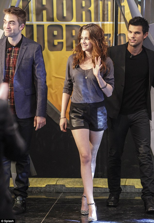Grunge goddess: Kristen Stewart wears a pair of short leather shorts and a slouchy T-shirt on Spanish chat show with Robert Pattinson and Taylor Lautner