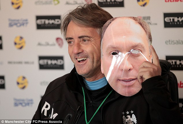 Game for a laugh: Mancini enjoys a chuckle at his Friday morning gag