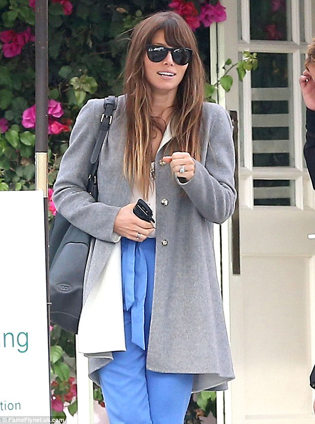 Flashing her rock: Jessica shows off her huge wedding ring as she waits for her car