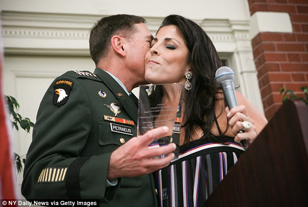Socialite: Kelley kisses General Petraeus at an awards ceremony for him at her home last year