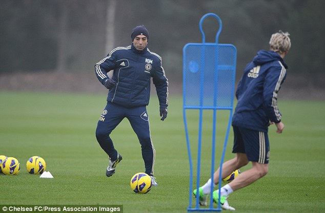 On the ball: Chelsea manager Roberto Di Matteo in training with Fernando Torres (right) at Cobham on Friday