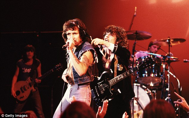 All-time record: AC/DC (singer Bon Scott and guitarist Angus Young pictured) managed 19 Top 40 hits without ever reaching the Top 10