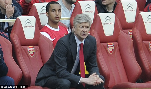 Out of action: Theo Walcott (back) has not always played as much as he would like