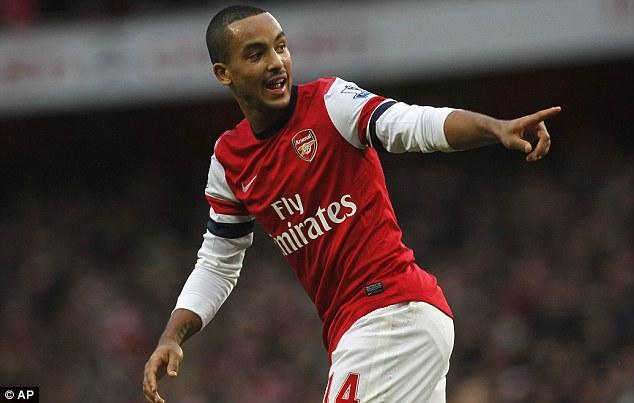 On target: Theo Walcott scored his ninth of the season against Tottenham