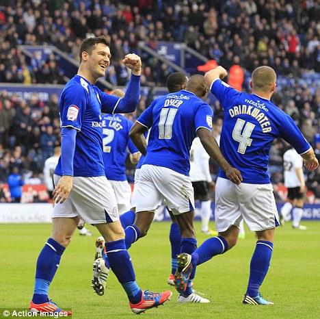 City slickers: David Nugent celebrates scoring the first goal