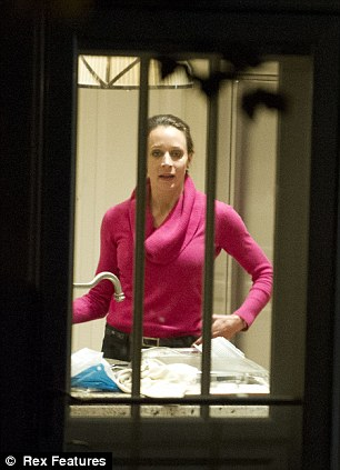 Hiding Out: Paula Broadwell was photographed on Tuesday evening from the kitchen of her brother Stephen Kranz's Washington D.C. house