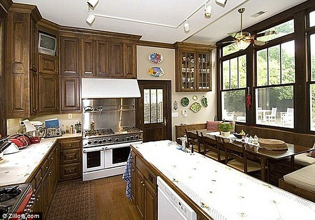The one-time mistress of David Petraeus was photographed in the kitchen of the $2.3 million property