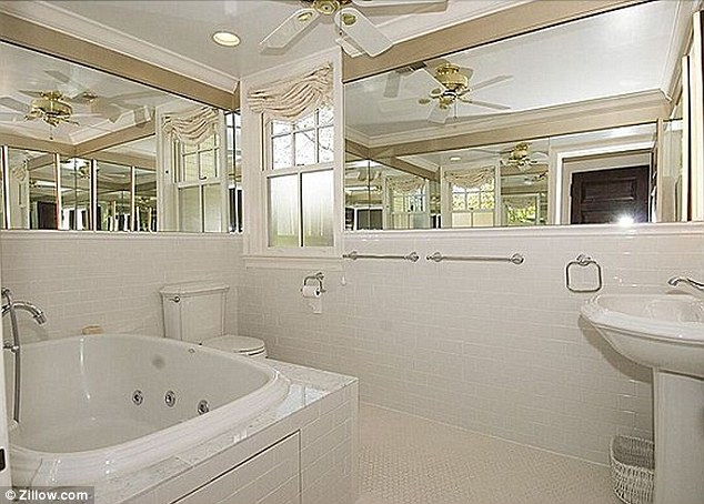 One of the five bedrooms inside the home which is situated in the afluent Mount Pleasant suburb