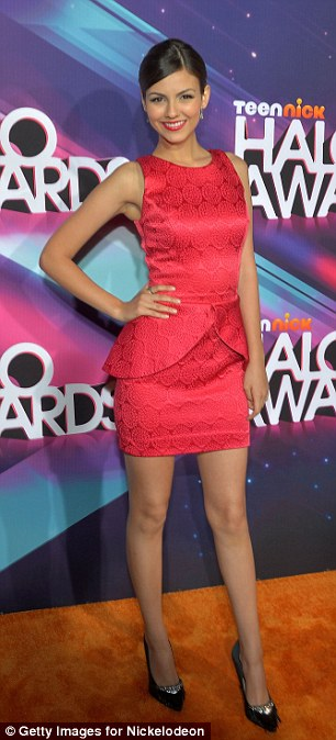 Red hot: Victoria Justice showed up in a little red number and bolero jacket, but ditched the wrap