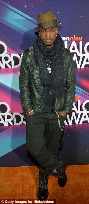 Back to basics: Actor Nathan Kress was elegant in a dress suit while Ne-Yo was casually chic in jacket, scarf and hat