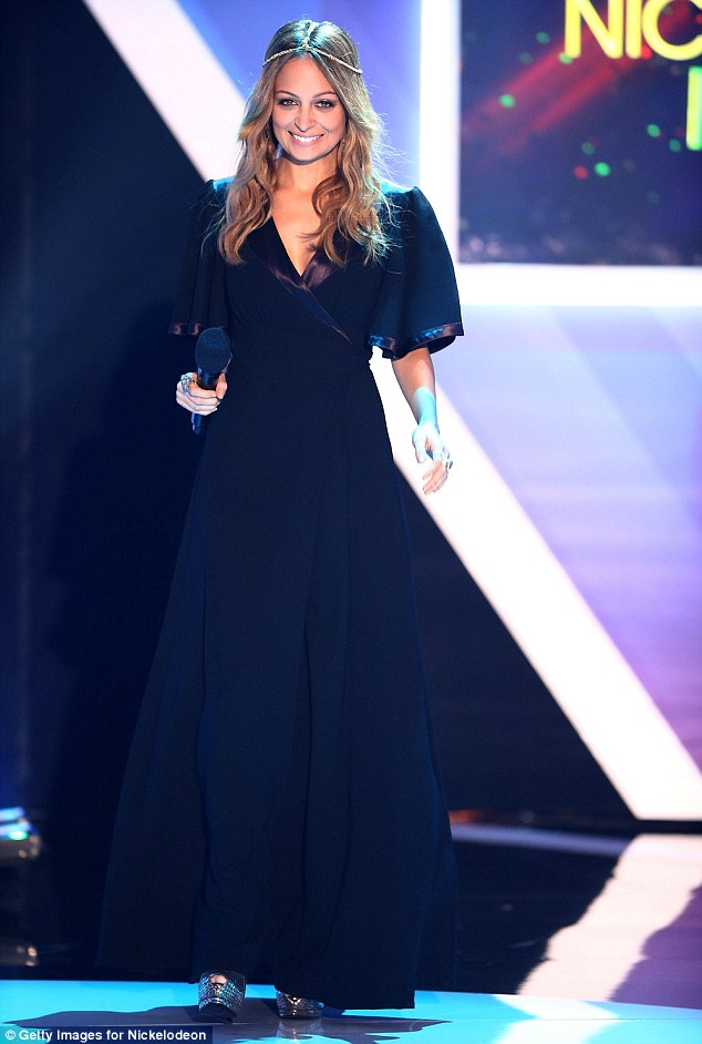 Breathtaking: Nicole Richie was a beauty in blue; she stepped on stage to give a speech during the show
