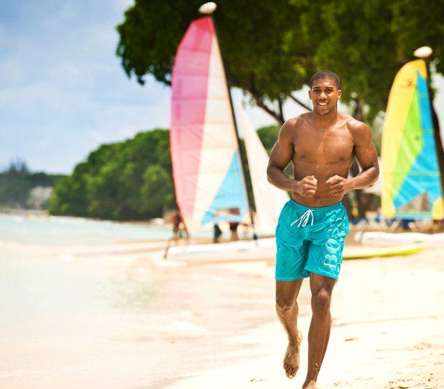 Boxer Anthony Joshua on the beach