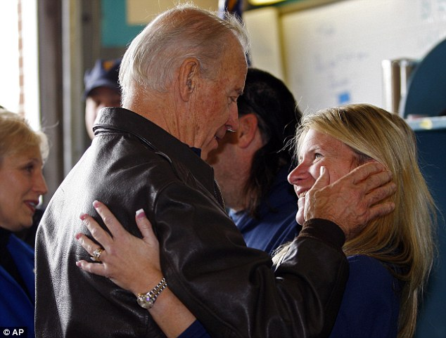 Strength: Biden comforted Seaside Heights resident Kim Samarelli during a visit to the town's volunteer fire department