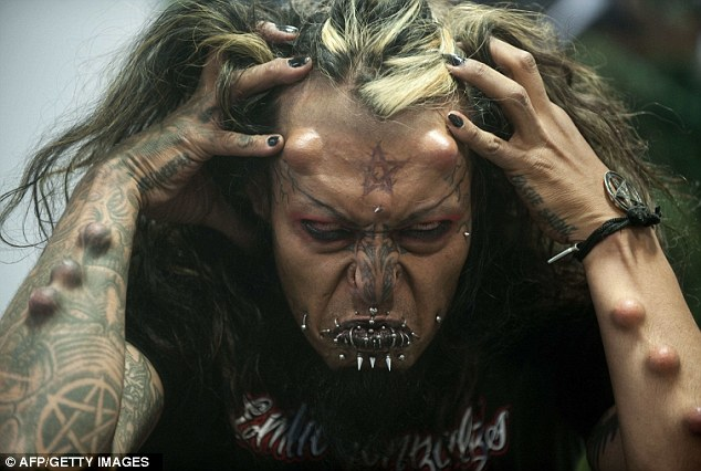 Striking: Colombian artist Cain Tubal performs during the third International Tattoo Convention