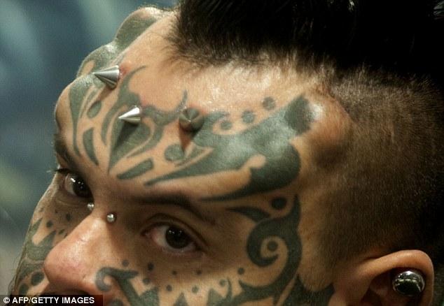 Shocking: Venezuelan Emilio Gonzalez performs during the Third International Tattoo Convention in Medellin, Antioquia department, Colombia