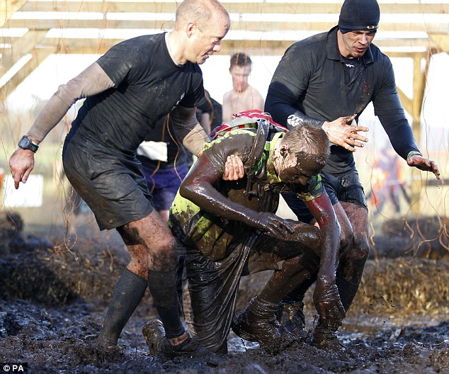 Tough love: Part of the ethos of the Tough Mudder is to help others through the course when it all gets a bit too much