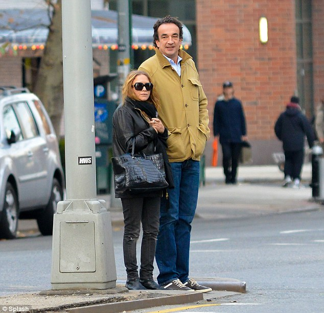 Long and the short of it: Mary-Kate Olsen and boyfriend Olivier Sarkozy were spotted strolling around New York's East Village on Sunday