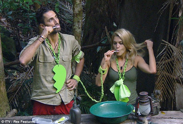 Gruesome toothsome: Hugo Taylor and Ashley Robertson brush their teeth in unison as part of the Bush Buddies challenge