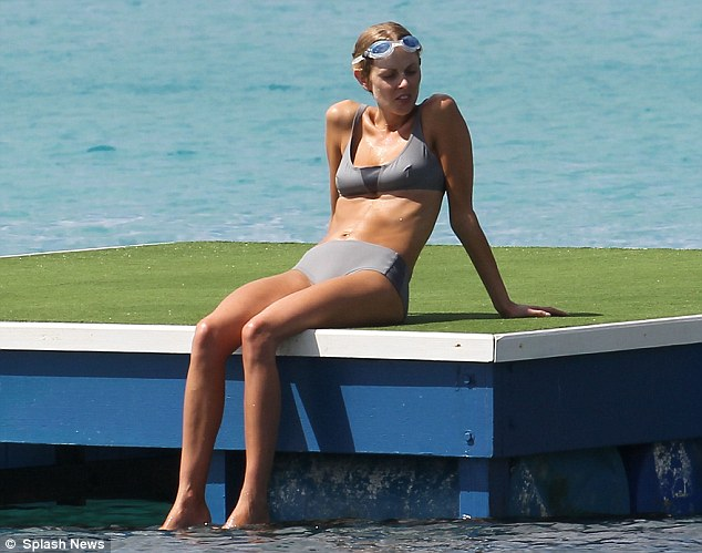 Beach babe: Donna Air takes a break from the sea to catch some rays