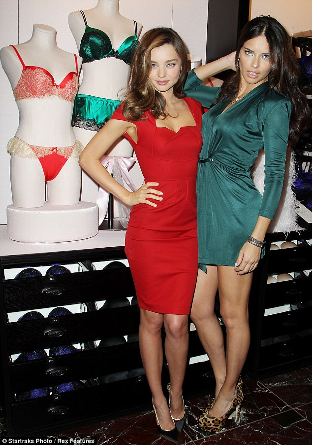 Strike a pose: Miranda sidled up to fellow Victoria's Secret model Adriana  Lima, who looked incredible in a very short green dress