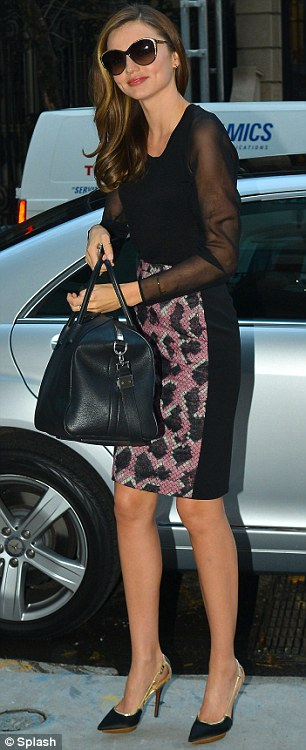 Stylish: The Australian star looked immaculate in a pencil-skirted dress and a black top with sheer sleeves