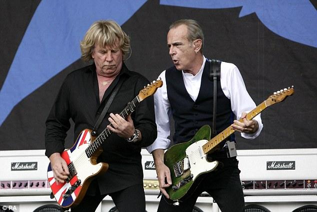 Still rocking: Rick Parfitt and Francis Rossi perform at Glastonbury in 2009