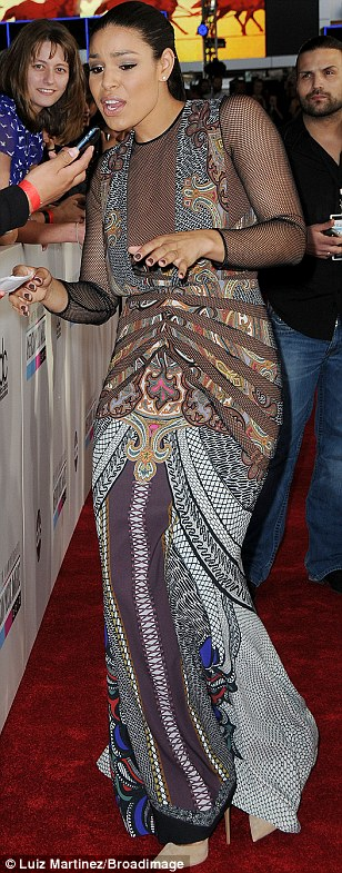 People person: Jordin was happy to greet her fans as she worked the red carpet