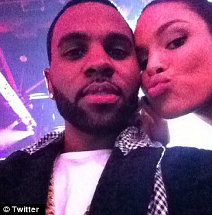 Big kiss: The pair continued to be mushy as they sat in the audience
