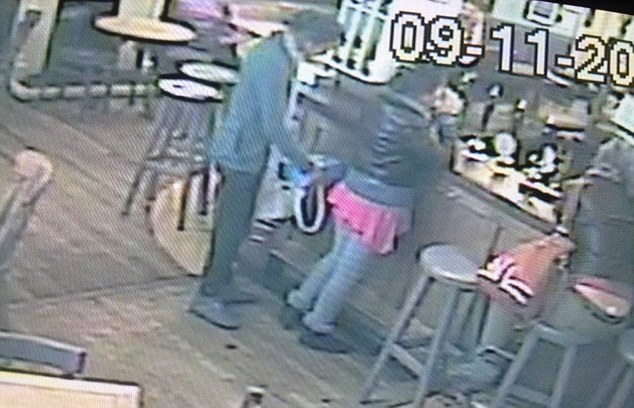 Moment of shame: The shocking moment a woman was caught on stealing a poppy collection box from The Barnsbury Pub